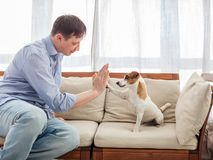 Man with dog at home Stock Photo