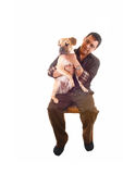 Man with dog on lap. Stock Image