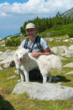 Man and Dog  on Mountain Pirin Royalty Free Stock Photography