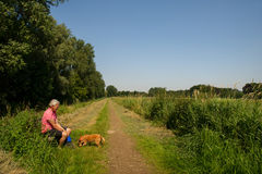 Man with dog in nature Royalty Free Stock Image