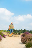 Man with dog in nature Stock Photography