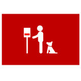 Man with dog near a dog poop bag dispenser Royalty Free Stock Images