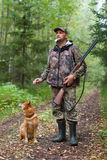 Man with dog out hunting for hazel grouse Royalty Free Stock Photo