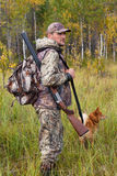 Man with dog out hunting Stock Photography