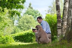 Man and dog outdoors Royalty Free Stock Photos