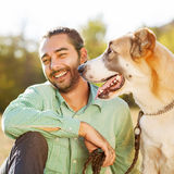 Man and dog outdoors Stock Photo
