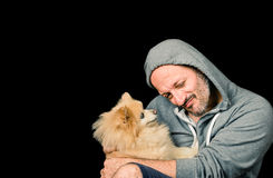 Man with Dog over black Background Royalty Free Stock Image