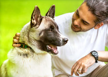 Man and Dog in the park. Stock Photos