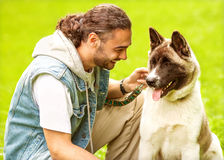 Man and Dog in the park. Royalty Free Stock Photos