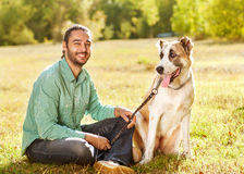 Man and dog in park Stock Photography