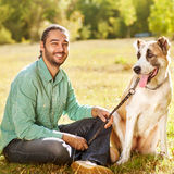 Man and dog in park Royalty Free Stock Photos