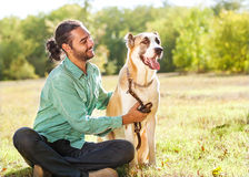 Man and dog in park Royalty Free Stock Images