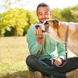 Man and dog in park Royalty Free Stock Photo
