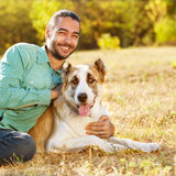 Man and Dog in the park. Stock Photo