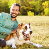 Man and Dog in the park. Royalty Free Stock Photography