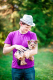 Man with dog in park. Happy man with small dog in the nature Stock Photos
