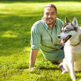 Man and Dog in the park. Royalty Free Stock Photo