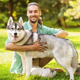 Man and Dog in the park. Stock Image