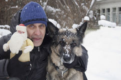 Man With Dog And Santa Royalty Free Stock Images