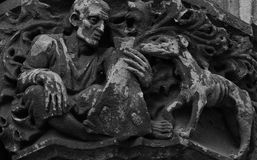 Man and dog. Shot in black and white. Placed on the facade of this historic building, sculpture on the capital representing man and dog. Set in Garraf, Sitges Royalty Free Stock Photo
