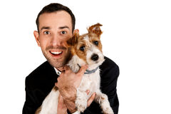 Man with dog smiling, isolated over white background. Stock Photo