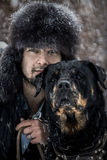 Man and dog in the snow Royalty Free Stock Image
