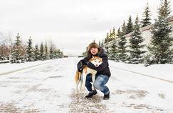 Man and dog in snow Royalty Free Stock Image