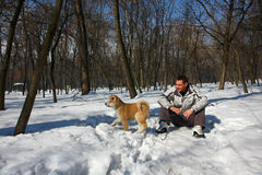 Man and dog on the snow Royalty Free Stock Photography
