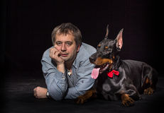 Man and dog in studio Stock Image