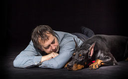 Man and dog in studio Stock Photos