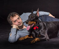 Man and dog in studio Stock Photo