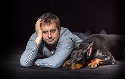 Man and dog in studio Royalty Free Stock Photography