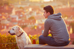 Man with dog at the sunrise Royalty Free Stock Image