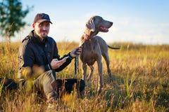 Man and dog. Man with weimaraner dog in nature Stock Photos