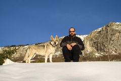 Man with dog in winter forest Stock Image