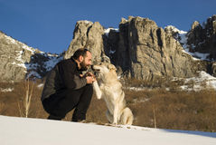 Man with dog in winter forest Royalty Free Stock Photo