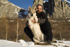 Man with dog in winter forest Royalty Free Stock Images