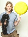 Man, Dog and Yellow Balloon Royalty Free Stock Photo