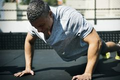 Free Man Doing A Push Up Stock Photography - 108016722