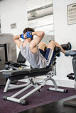 Man doing abdominal crunches on bench Royalty Free Stock Photo