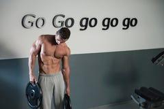 Man Doing Abs Exercise. Strong Bodybuilder Training His Six Pack. Man Doing Abs Exercise Stock Photo