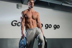 Man Doing Abs Exercise. Strong Bodybuilder Training His Six Pack. Man Doing Abs Exercise Royalty Free Stock Photos
