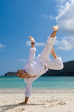 Man doing acrobat on the beach Stock Image