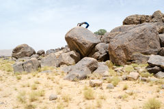 Man doing acrobatic movements on a rock Royalty Free Stock Photos