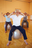 Man doing back exercises Stock Photo