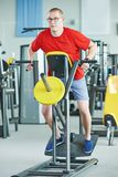 Man doing back exercises at fitness gym Royalty Free Stock Photography