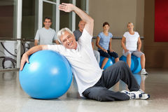 Man doing back exercises with gym Stock Image