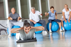 Man doing back exercises in gym Stock Photos