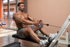Man Doing Back Exercises In The Gym Royalty Free Stock Photo