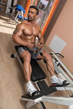 Man Doing Back Exercises In The Gym Stock Photography